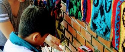 A volunteer with children in Vietnam teaches basic hygiene as part of our project for teenagers